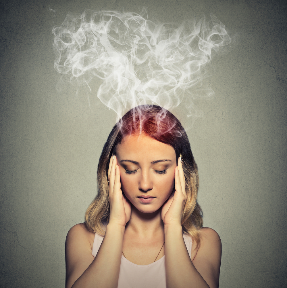 Portrait young stressed woman thinking too hard steam coming out up of head isolated on grey wall background. Face expression emotion perception-1